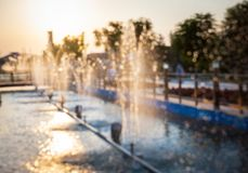 Fountain by sunset,blur scene Royalty Free Stock Photo