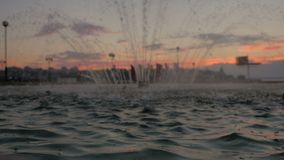 Fountain at sunset. Water drops. Slow motion stock video