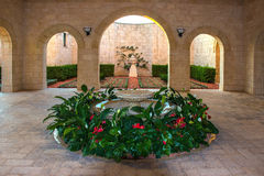 The fountain surrounded by flowers in the temple of Bahai Royalty Free Stock Images