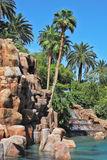 The fountain surrounded by tropical vegetation Royalty Free Stock Photography