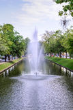 Fountain system in the middle of street in the city Stock Photos