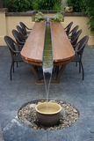 Fountain Table. A unique, artistic patio table with a water feature running through its center stock images