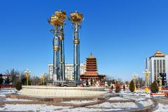 Fountain Three lotus at central square in spring. Elista. Kalmykia. Russia. Elista, Kalmykia, Russia - March 6, 2018: Fountain Three lotus at central square in royalty free stock image