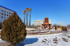 Fountain Three lotus and Pagoda of the Seven Days at central square in spring. Elista. Kalmykia. Russia. Elista, Kalmykia, Russia - March 6, 2018: Fountain Three stock photos