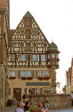 Fountain and timber-frame house. Timber-frame house and stone fountain in Rothenburg ob der Tauber, Germany Date taken: August 4, 2012 stock images