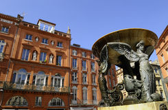 Fountain in Toulouse. View of French brick buildings and fountain in Toulouse Stock Photos