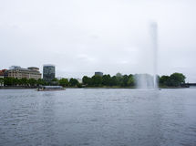 Fountain and tourist boat on Alster lake, Hamburg Stock Images