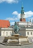 Fountain and Town Hall tower on marketplace in Poznan Royalty Free Stock Images