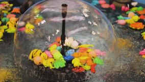Fountain toys splash water play  catch  fish game. A fountain with toys floating spinning splash water play catch fish game stock footage