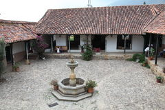 The fountain. A traditional house in colombia Royalty Free Stock Images