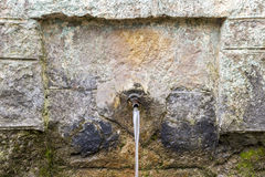 Fountain of Tran. Old village stone fountain of Tran royalty free stock photo