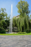 Fountain in trees against blue sky Royalty Free Stock Image