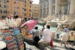 Fountain Of Trevi, Rome, Italy. Tourist in Rome, Italy relax by Fountain of Trevi Royalty Free Stock Photo