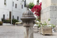 Plaza with fountain of two pipes in Aín, Castellón, Spain. Fountain of two heads in Aín, village of the Sierra de Espadán in the province of Castellón Stock Images