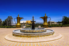 Fountain and two huge jars decorate the courtyard, Morocco Stock Image