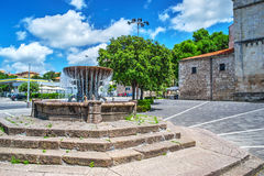 Fountain under a blue sky with clouds Stock Photos