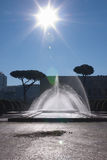 Fountain under the sun. A fountain in the Eur district in Rome, Italy Stock Image