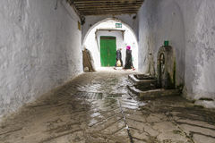 Fountain under whitewashed arch, Tetouan, Morocco Royalty Free Stock Images