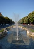 Fountain on Unirii Boulevard, Bucharest, Romania. Looking down Unirii Boulevard through a fountain towards Piata Unirii (Unification Square royalty free stock photography