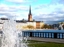 Fountain and a view of Stockholm. Malaren lake and buildings in Stockholm view from the town hall fountain royalty free stock photography