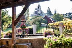 Fountain of village of Hunawihr. Old fountain and church of the village of Hunawihr, Alsace, France Stock Image