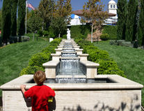Fountain Watcher. A child watches the water trickle in over a terraced fountain at a public garden in Thousand Oaks, California Stock Photography