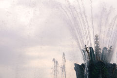 Fountain water splashes on cloudy sky Stock Image
