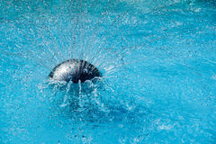 Fountain . Water splashing into swimming pool Stock Images