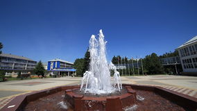 Fountain water summer blue sky flow square stock video