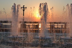 The fountain on the waterfront. The sunset, the fountain on the waterfront royalty free stock image