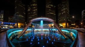 Fountain of Wealth, Singapore. Fountain show at Fountain of Wealth, Suntec City, Singapore. Fountain of Wealth is biggest fountain in Singapore Stock Photo