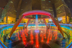Fountain of Wealth with Suntec Towers at dusk Stock Photos