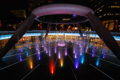 Fountain of Wealth with Suntec Towers at night in Singapore Stock Image