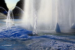 Fountain in winter. Frozen water fountain in winter in a park Stock Photos