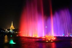 Fountain With Colorful Illuminations At Night Near The Shwedagon Pagoda Royalty Free Stock Images