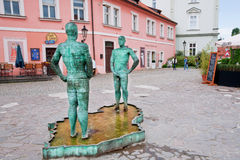 Fountain With Two Men Near The Museum Of Franz Kafka Royalty Free Stock Images