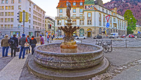 Fountain with woman statue in the Old Town of Chur Royalty Free Stock Photo