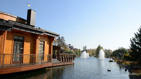 The fountain and wooden house in Mezhigirya, Ukraine. It is former residence of ex-president Yanukovich, now open to the public stock video