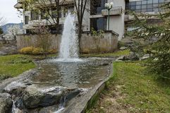 Fountainin like natural spring in the central square of Pravets. (Pravetz) town, Bulgaria stock photo