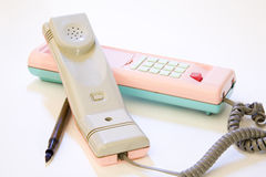 Fountainpen and pink phone. Pink telephone with a pen to write numbers Stock Image