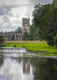 Fountains Abbey. With reflection in water North Yorkshire England Stock Photos
