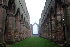 Fountains Abbey. Arches and vaults in the fog. Vaults and arches of the ruins of the abbey royalty free stock photo