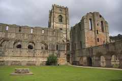 Fountains Abbey Cloisters. Fountains Abbey near to Ripon in North Yorkshire, England. The remains of a Cistercian monastery, and the largest Abbey ruins in Stock Photos