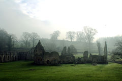 Fountains Abbey. Foggy morning in January. Foggy landscape of the abbey in the green grass, blowing romanticism and mysticism stock photo