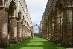 Fountains Abbey - Yorkshire - England. The ruins of the Fountains Abbey in North Yorkshire, England royalty free stock image