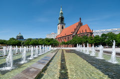 Fountains on Alexanderplatz and St. Mary's Church Royalty Free Stock Photo