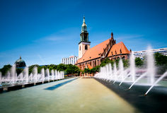 Fountains on Alexanderplatz and St. Mary's Church Royalty Free Stock Image