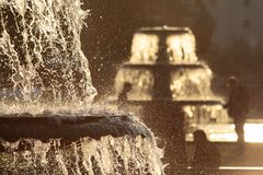 Fountains in back light Stock Photography