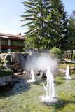 Fountains in Bansko. View of fountains and pine trees in the center of Bansko. Bansko is a town in southwestern Bulgaria, located at the foot of the Pirin Royalty Free Stock Image