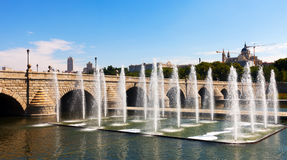 Fountains and bridge over Manzanares river Stock Photos